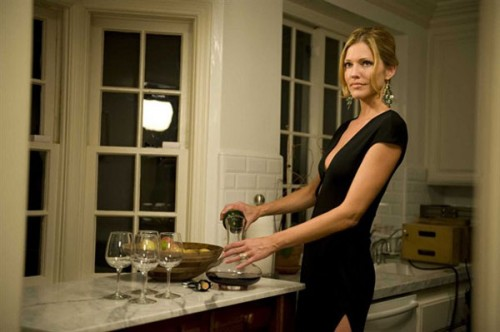 Tricia Helfer pours the red in 'Open House'